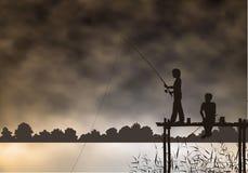 Ragazzi di pesca Immagini Stock