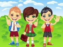 Ragazzi e ragazza sorridenti degli scolari di vettore Fotografia Stock