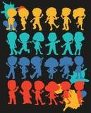 Ragazzi e ragazze della siluetta Fotografia Stock