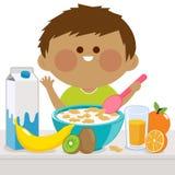 Ragazzino che mangia prima colazione illustrazione vettoriale