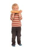 Ragazzino con il panino fotografie stock