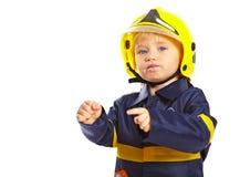 Ragazzino in costume del vigile del fuoco Fotografia Stock