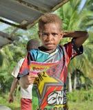 Ragazzino di Papuan con il taccuino Fotografia Stock Libera da Diritti