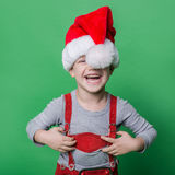 Ragazzino divertente con la risata del cappello di Santa Claus Concetto di Natale Fotografia Stock Libera da Diritti