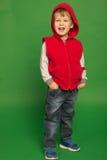 Ragazzino in jeans ed in una maglia con cappuccio Fotografia Stock Libera da Diritti