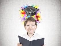 Ragazzino sveglio con un libro, istruzione Immagini Stock Libere da Diritti