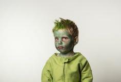 Ragazzino triste vestito come zombie Immagine Stock Libera da Diritti