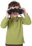 Ragazzo adorabile con il binocolo Fotografie Stock