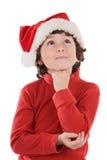Ragazzo adorabile con il cappello rosso di natale immagine stock