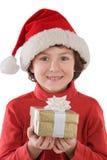 Ragazzo adorabile con il cappello rosso di natale e di un GIF fotografie stock