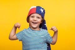 Ragazzo adorabile con la bandiera americana Immagini Stock