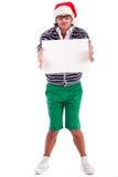 Ragazzo allegro della Santa con una scheda in bianco Fotografia Stock Libera da Diritti