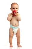 Ragazzo anziano di un anno con la mela rossa sopra bianco Fotografia Stock