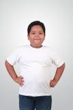 Ragazzo asiatico grasso che sorride felicemente Immagini Stock
