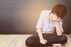 Ragazzo asiatico triste Fotografia Stock