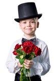 Ragazzo bello in vestito classico con i fiori isolati Fotografie Stock