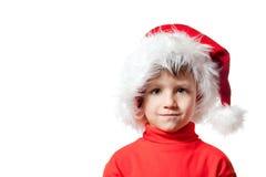 Ragazzo in cappello del Babbo Natale Fotografia Stock Libera da Diritti