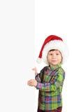 Ragazzo in cappello della Santa con la scheda in bianco Immagini Stock Libere da Diritti