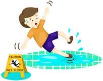 Ragazzo che cade sul pavimento bagnato Fotografia Stock Libera da Diritti