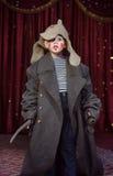 Ragazzo che dura sopra il pagliaccio d'uso graduato Make Up del cappotto Fotografia Stock