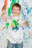 Ragazzo che gioca con la pittura Fotografia Stock Libera da Diritti