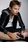 Ragazzo che gioca gioco di computer Fotografie Stock Libere da Diritti