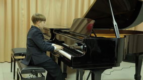 Boy playing the grand piano Stock Footage