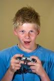 Ragazzo che gioca un video gioco Fotografia Stock Libera da Diritti