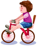 Ragazzo che guida una bicicletta Immagine Stock