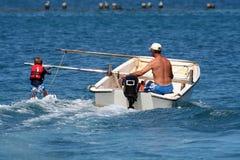 Ragazzo che impara waterski Fotografia Stock Libera da Diritti