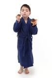 Ragazzo che mangia ciambella Fotografie Stock Libere da Diritti