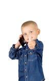 Ragazzo che parla sul telefono Immagine Stock