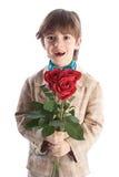 Ragazzo che tiene le rose rosse Fotografie Stock Libere da Diritti