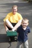 Ragazzo che tira papà in vagone Fotografia Stock Libera da Diritti