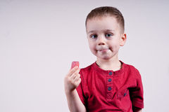Ragazzo con la caramella Fotografia Stock