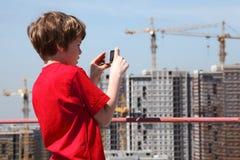 Ragazzo con la costruzione della foto della macchina fotografica Fotografia Stock