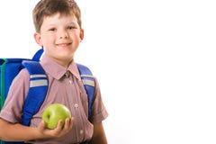 Ragazzo con la mela Fotografie Stock