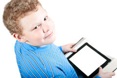 Ragazzo con un computer della compressa Fotografie Stock