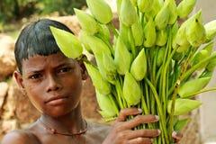Ragazzo con un mazzo dei lotuses Fotografia Stock Libera da Diritti