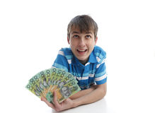 Ragazzo con un ventilatore delle banconote dei soldi Fotografia Stock