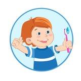 Ragazzo con uno spazzolino da denti a disposizione Dare del ragazzo pollici aumenta il gesto del segno Fotografia Stock