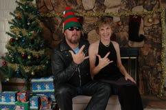 Ragazzo del motociclista con il cappello dell'elfo e la sua donna Immagini Stock