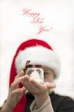 Ragazzo di Natale con la candela stupefacente della decorazione Immagine Stock Libera da Diritti