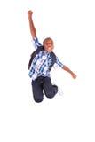 Ragazzo di scuola afroamericano che salta - persone di colore Fotografia Stock