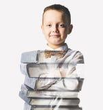 Ragazzo di scuola misto con il mucchio dei libri Fotografia Stock