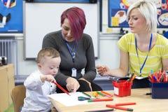 Ragazzo di sindrome di Down alla scuola materna Immagine Stock Libera da Diritti
