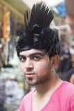 Ragazzo divertente con capelli artificiali Fotografia Stock