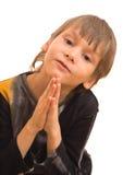 Ragazzo divertente di preghiera Immagine Stock