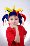 Ragazzo divertente nel cappello del pagliaccio Immagini Stock Libere da Diritti