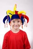 Ragazzo divertente nel cappello del pagliaccio Fotografia Stock